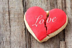 Cracked heart shaped cookie Stock Images