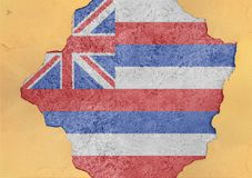 Cracked hole with US state Hawaii flag abstract in facade structure. Big damaged concrete stock images