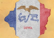 Cracked hole with US state Iowa flag abstract in facade structure royalty free stock photos