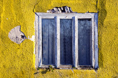 Cracked house wall and old window frame Royalty Free Stock Photography