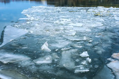 Cracked ice floating on river water surface Stock Photography