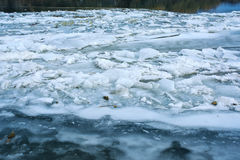 Cracked ice floating on river water surface Stock Image