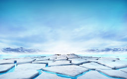Cracked ice floe floating on blue water mountain lake Royalty Free Stock Photography