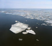 Cracked ice floes on a frozen sea. Stock Photos