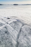 Cracked ice at a frozen lake Stock Photo