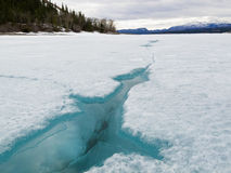 Cracked ice of frozen Lake Laberge Yukon Canada Royalty Free Stock Photography