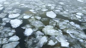 Cracked Ice Icebergs flows slowly drifting through the dark water of the river. Filmed from above stock video