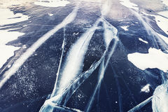 Cracked ice on lake Stock Photos