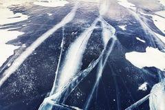 Cracked ice on lake Stock Photos