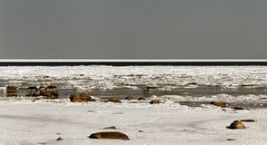 Cracked ice on sea surface. Stock Photo