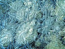 Cracked ice surface. Blue and green Royalty Free Stock Photos