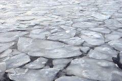 Cracked ice surface on frozen water Stock Photo