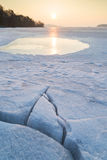 Cracked ice and water at a frozen lake Royalty Free Stock Photos