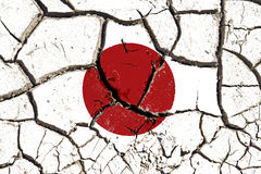 Cracked Japan flag. Cracked soil as Japan flag to symbolize the recent earthquake and calamity that struck this country stock images