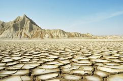 Cracked land and Dry Mountain stock images