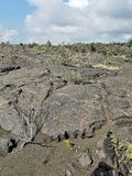 Cracked Lava Rocks and Finely Ground Lava Sand Stock Images