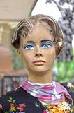Cracked mannequin face. Cracked mannequin portrait in local outdoor market Stock Images