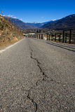 Cracked mountain road Royalty Free Stock Image