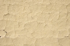 Cracked mud plaster wall closeup Stock Photos
