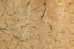 Cracked mud wall. Close up shot of an adobe mud wall with lots of cracks Stock Photography