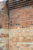 Cracked old building brick wall with eroded bricks Royalty Free Stock Photos