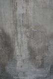 Cracked old gray cement concrete stone wall Royalty Free Stock Images