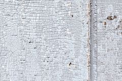 Cracked old paint texture. Fragment of an old wooden door Royalty Free Stock Images