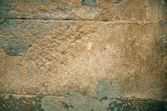 Cracked old stone wall background, dark grunge texture close up Stock Photo