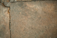 Cracked old stone wall background, dark grunge texture close up Stock Images