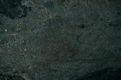 Cracked old stone wall background, dark grunge texture close up Royalty Free Stock Photography