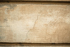 Cracked old stone wall background, dark grunge texture close up Royalty Free Stock Image