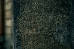 Cracked old stone wall background, dark grunge texture close up Royalty Free Stock Images