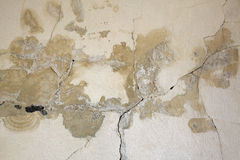 Cracked old wall background damaged and stained Stock Photos