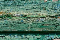Cracked paint. Wooden boards with cracked paint royalty free stock images