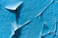 The cracked  paint. The cracked blue paint abstract background Royalty Free Stock Image
