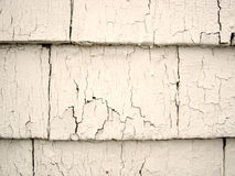 Cracked Paint. On some very old cedar shingles stock photography