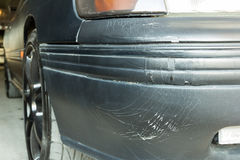 Cracked paint on car bumper Stock Images