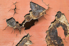 Cracked paint on rusty iron Royalty Free Stock Photo