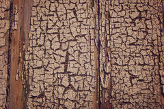 Cracked paint on the wall. Old wood surface. Stock Images