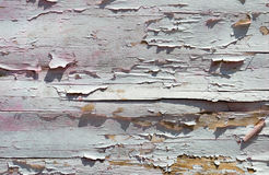 Cracked paint on a wooden wall from planks. Grunge background Royalty Free Stock Image