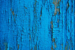 Cracked paint on a wooden wall. Stock Photo
