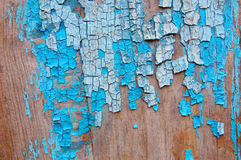 Cracked paint on a wooden wall. Wall from wooden planks with paint traces. Royalty Free Stock Images