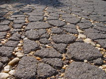 Cracked pavement. Old cracked pavement with small pebbles Royalty Free Stock Photo