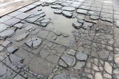 Cracked pavement slabs Stock Photos
