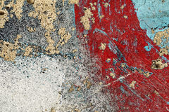 Cracked peeled red grey turquoise paint on old damaged wall Royalty Free Stock Images