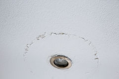 Cracked peeling layer on ceiling Stock Photography