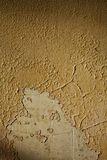 Cracked and peeling paint. A closeup view of old cracked and peeling paint on a wall Royalty Free Stock Image