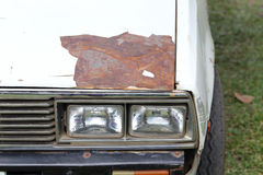 Cracked and peeling paint of an old car. Peeling paint of an old car Stock Photography