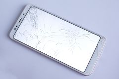 Cracked phone screen, broken and crushed cell phone sensor. on white background stock photo