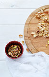 Cracked pistachio nuts. On wooden board Royalty Free Stock Images